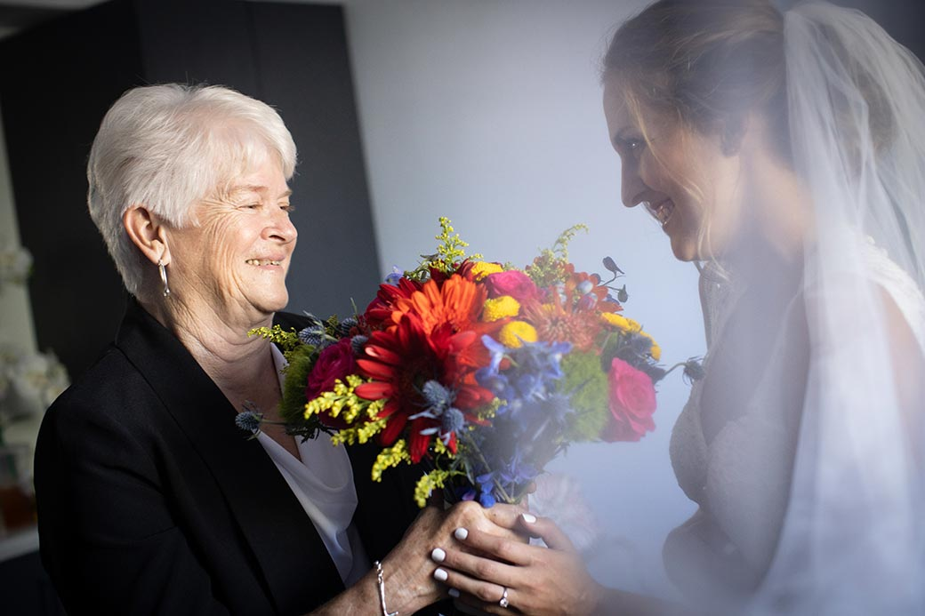 Barronelle Stutzman hands wedding bouquet to bride