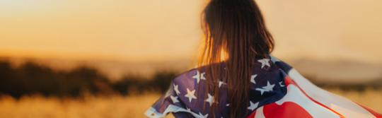 Girl with American Flag in Field