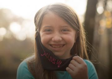 "ADF client Lydia Booth and her ""Jesus Loves Me"" Mask"